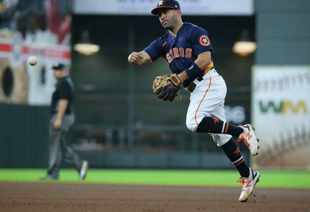 Houston Astros second baseman Jose Altuve (27) throws to first during the top fourth inning of the MLB game against the New York Yankees Sunday, July 11, 2021, from Minute Maid Park in Houston. Photo: Yi-Chin Lee, Staff Photographer / © 2021 Houston Chronicle
