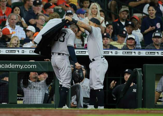 New York Yankees second baseman Rougned Odor, right, puts a coat around Tim Locastro (33) to celebrate his single home run during the top fourth inning of the MLB game against the Houston Astros Sunday, July 11, 2021, from Minute Maid Park in Houston. Photo: Yi-Chin Lee, Staff Photographer / © 2021 Houston Chronicle