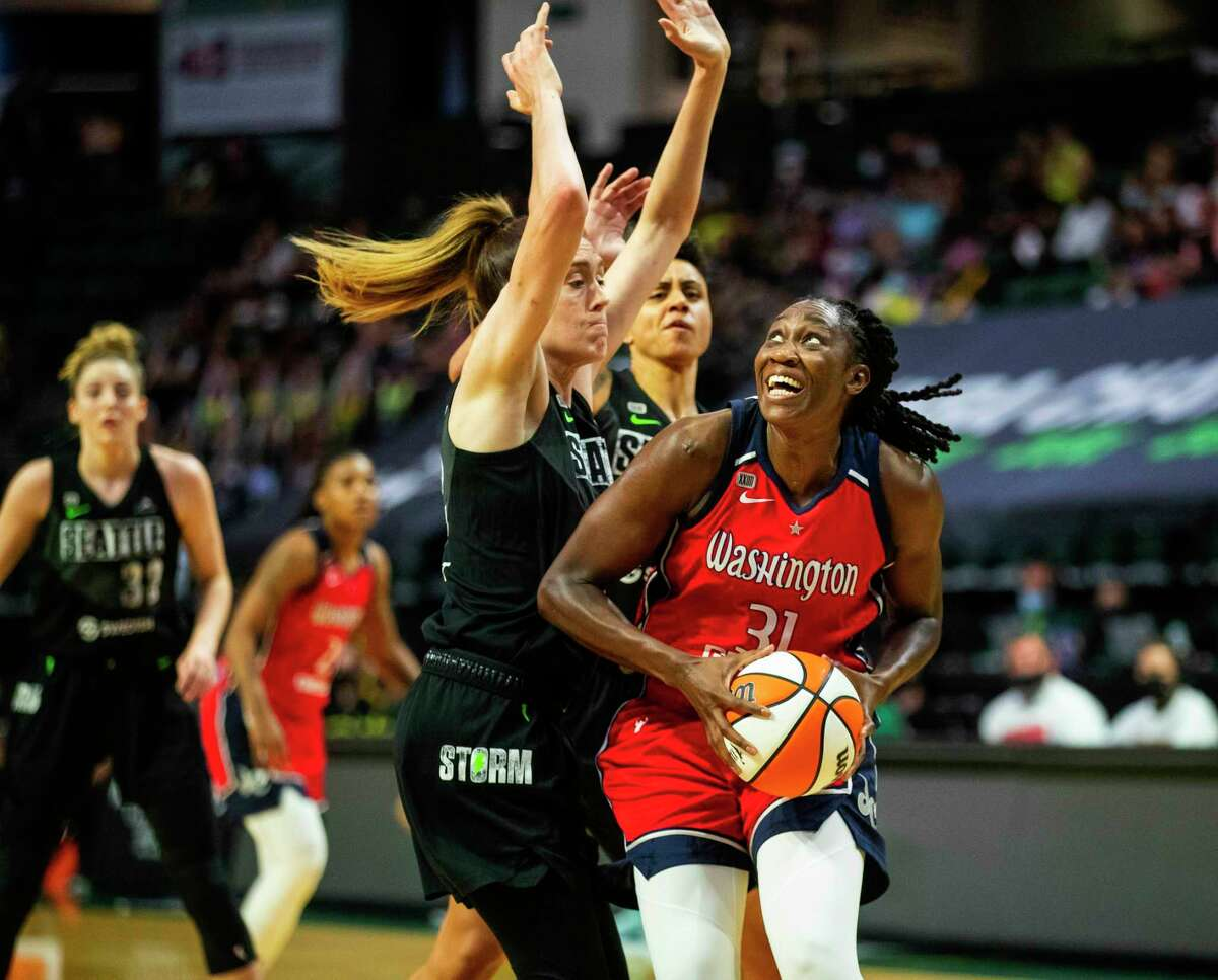 Seattle Storm's Breanna Stewart, left, defends Washington Mystics' Tina Charles (31) during the first half of a WNBA basketball game, Tuesday, June 22, 2021 in Everett, Wash.
