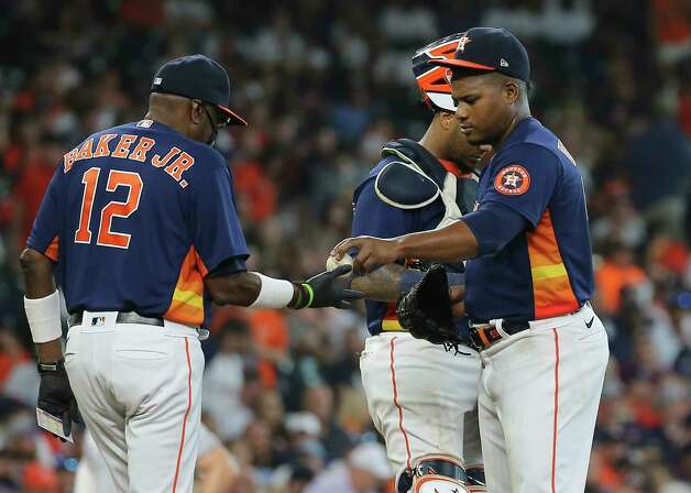 Houston Astros manager Dusty Baker Jr. (12) takes the ball from starting pitcher Framber Valdez (59) after four innings against the New York Yankees of the MLB game Sunday, July 11, 2021, from Minute Maid Park in Houston. Photo: Yi-Chin Lee, Staff Photographer / © 2021 Houston Chronicle