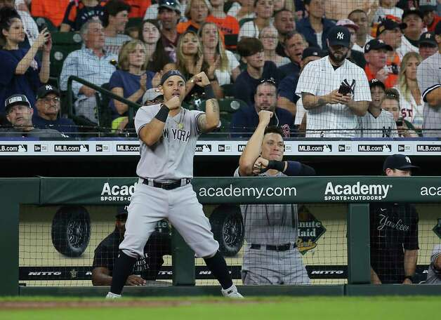 New York Yankees players Rougned Odor, left, and Aaron Judge celebrate the team scoring the third run during the top fifth inning of the MLB game against the Houston Astros Sunday, July 11, 2021, from Minute Maid Park in Houston. Photo: Yi-Chin Lee, Staff Photographer / © 2021 Houston Chronicle