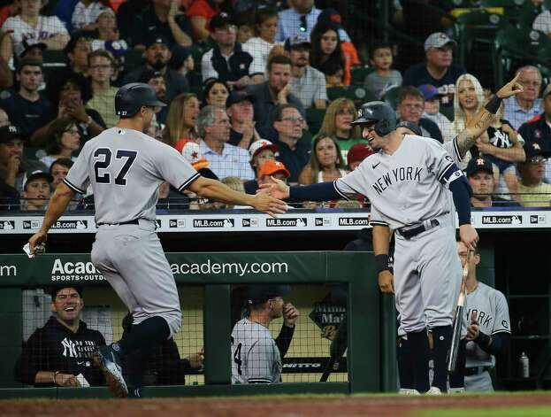 New York Yankees designated hitter Giancarlo Stanton (27) scores the team's third run during the top fifth inning of the MLB game against the Houston Astros Sunday, July 11, 2021, from Minute Maid Park in Houston. Photo: Yi-Chin Lee, Staff Photographer / © 2021 Houston Chronicle