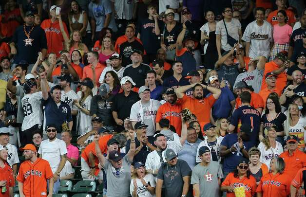 Houston Astros and New York Yankees fans react differently when New York Yankees right fielder Aaron Judge (99) catches a deep fly ball by Houston Astros right fielder Chas McCormick (20) during the bottom sixth inning of the MLB game Sunday, July 11, 2021, from Minute Maid Park in Houston. Photo: Yi-Chin Lee, Staff Photographer / © 2021 Houston Chronicle