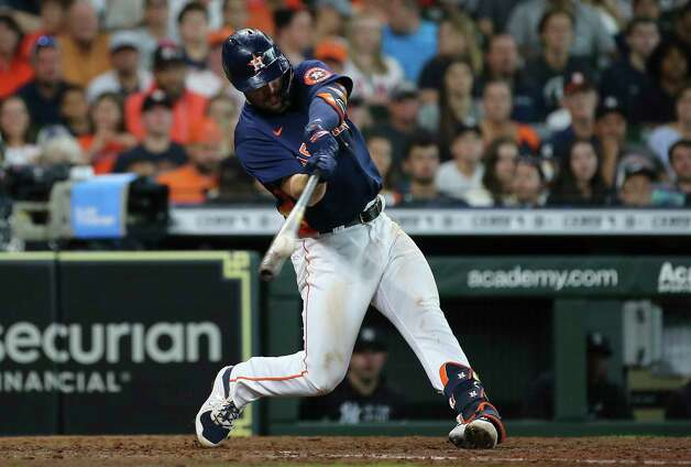 Houston Astros right fielder Chas McCormick (20) hits a fly ball to right and out during the bottom sixth inning of the MLB game against the New York Yankees Sunday, July 11, 2021, from Minute Maid Park in Houston. Photo: Yi-Chin Lee, Staff Photographer / © 2021 Houston Chronicle