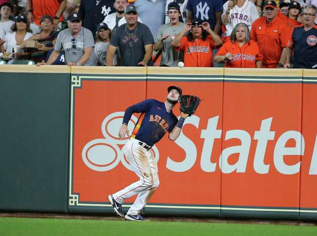 Houston Astros left fielder Kyle Tucker (30) catches a fly ball during the top seventh inning of the MLB game against the New York Yankees Sunday, July 11, 2021, from Minute Maid Park in Houston. Photo: Yi-Chin Lee, Staff Photographer / © 2021 Houston Chronicle
