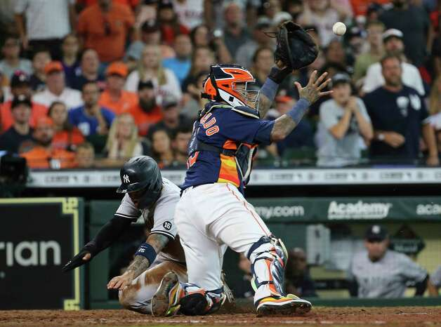 New York Yankees shortstop Gleyber Torres (25) slides past Houston Astros catcher Martin Maldonado (15) as he is going for the home plate during the top seventh inning of the MLB game Sunday, July 11, 2021, from Minute Maid Park in Houston. Photo: Yi-Chin Lee, Staff Photographer / © 2021 Houston Chronicle