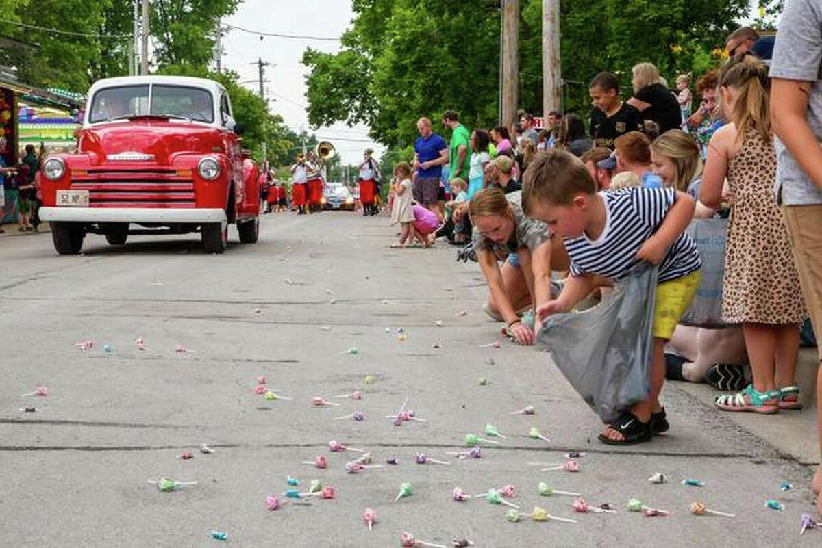 Maryville Fire Department's annual Homecoming celebration gave families a chance to enjoy the village's small-town summer spirit with rides, food and music. Pictured is a child picking up a piece of candy during the first of two children's parades, which took place during the two-day celebration on Friday and Saturday.