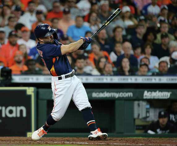 Houston Astros second baseman Jose Altuve (27) swings at New York Yankees starting pitcher Jameson Taillon (50) during the bottom third inning of the MLB game Sunday, July 11, 2021, from Minute Maid Park in Houston. Photo: Yi-Chin Lee, Staff Photographer / © 2021 Houston Chronicle