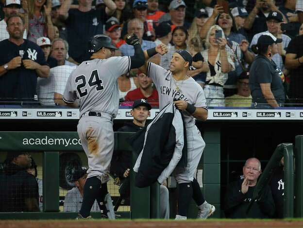 New York Yankees catcher Gary Sanchez (24) celebrates his three-run home run with Rougned Odor (18) during the top eighth inning of the MLB game against the Houston Astros Sunday, July 11, 2021, from Minute Maid Park in Houston. Photo: Yi-Chin Lee, Staff Photographer / © 2021 Houston Chronicle