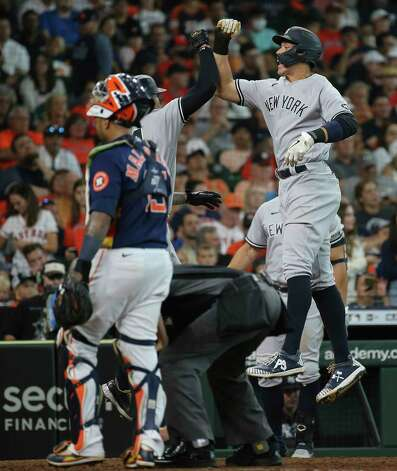 New York Yankees players Gary Sanchez (24) and Aaron Judge (99) celebrate Sanchez's three-run home run during the top eighth inning of the MLB game against the Houston Astros Sunday, July 11, 2021, from Minute Maid Park in Houston. Photo: Yi-Chin Lee, Staff Photographer / © 2021 Houston Chronicle