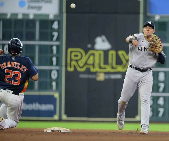 New York Yankees third baseman Gio Urshela (29) outs Houston Astros left fielder Michael Brantley (23) at second in a double play during the bottom eighth inning of the MLB game Sunday, July 11, 2021, from Minute Maid Park in Houston. Photo: Yi-Chin Lee, Staff Photographer / © 2021 Houston Chronicle