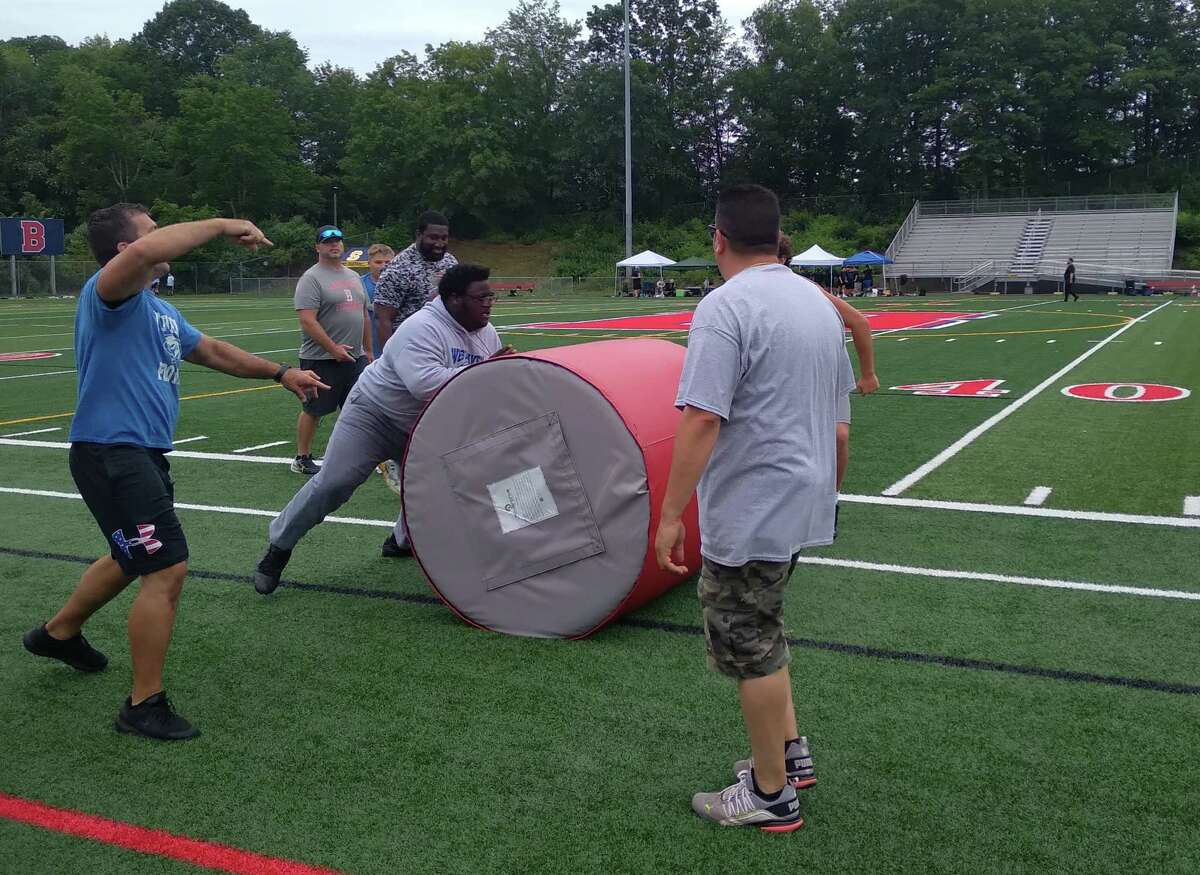 West Haven's Kyshawn Togba competes in the Berlin Lineman Challenge at Sage Park in Berlin on Saturday.