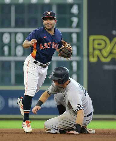 Houston Astros second baseman Jose Altuve (27) has a smile on his face after performing a double play during the top ninth inning of the MLB game against the New York Yankees Sunday, July 11, 2021, from Minute Maid Park in Houston. Photo: Yi-Chin Lee, Staff Photographer / © 2021 Houston Chronicle