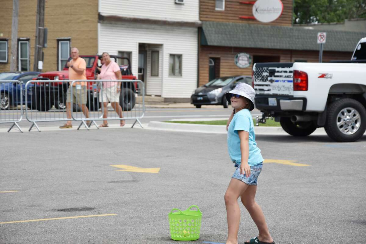 Throw the ball and hit the target. That is the way one sends the dunk tank operator into the water at Bear lake Days.