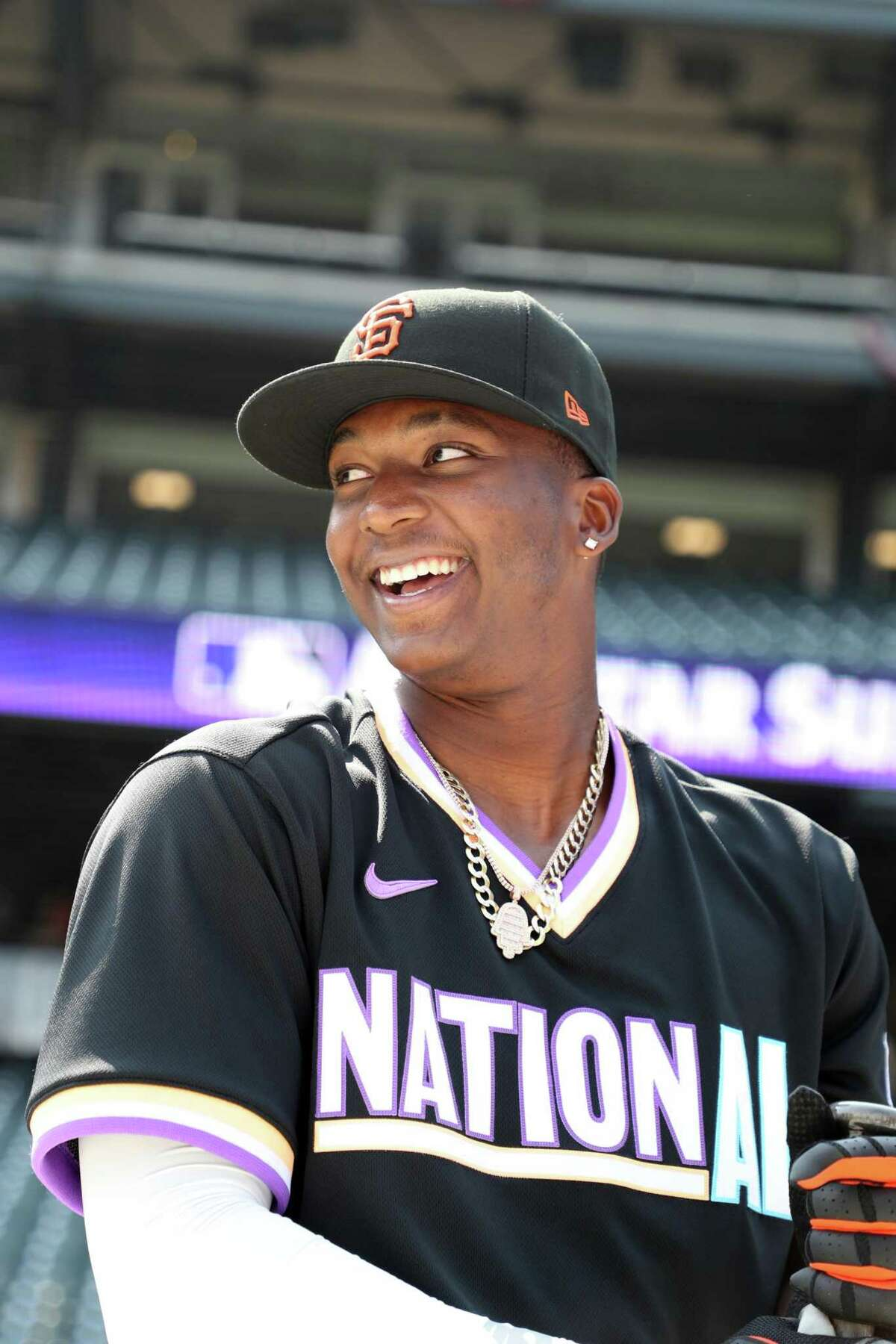DENVER, CO - JULY 11: Marco Luciano #10 of the National League Team smiles before the 2021 Sirius XM Futures Game at Coors Field on Sunday, July 11, 2021 in Denver, Colorado. (Photo by Rob Tringali/MLB Photos via Getty Images)