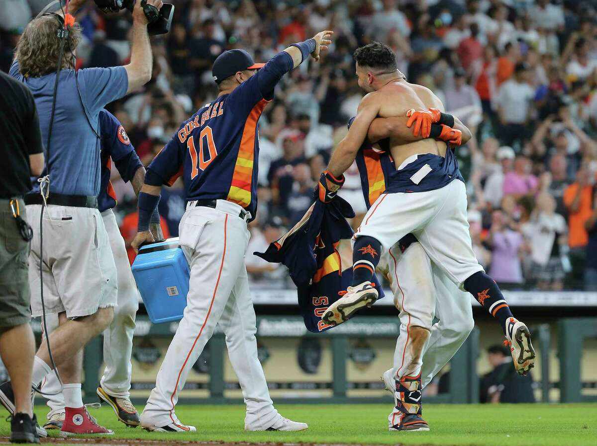 Houston Astros left fielder Michael Brantley (23) lifts second baseman Jose Altuve (27) up after Altuve hit a walk off three-run home run and the Astros defeated New York Yankees 8-7 in a MLB game Sunday, July 11, 2021, from Minute Maid Park in Houston.