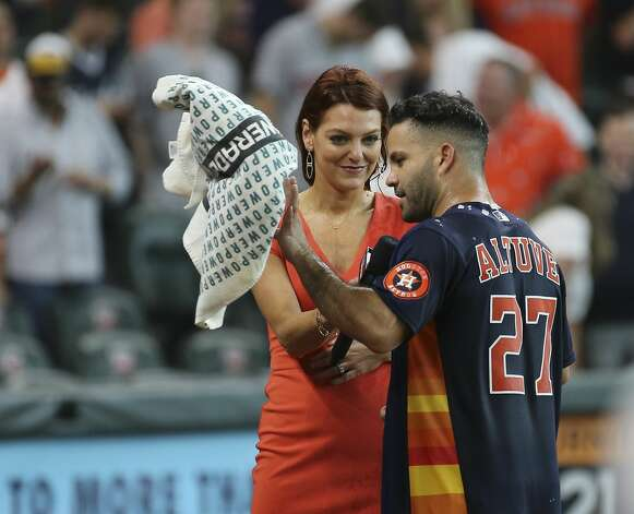 Houston Astros second baseman Jose Altuve gives an after-game interwith with field reporter Julia Morales after his walk-off three-run home run and the Astros defeated New York Yankees 8-7 in a MLB game Sunday, July 11, 2021, from Minute Maid Park in Houston. Photo: Yi-Chin Lee/Staff Photographer / © 2021 Houston Chronicle