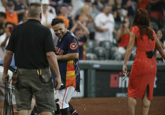 Houston Astros starting pitcher Lance McCullers Jr. (43) dumps gatorade over Jose Altuve and field reporter Julia Morales after Altuve hit a walk-off three-run home run and the Astros defeated New York Yankees 8-7 in a MLB game Sunday, July 11, 2021, from Minute Maid Park in Houston. Photo: Yi-Chin Lee/Staff Photographer / © 2021 Houston Chronicle