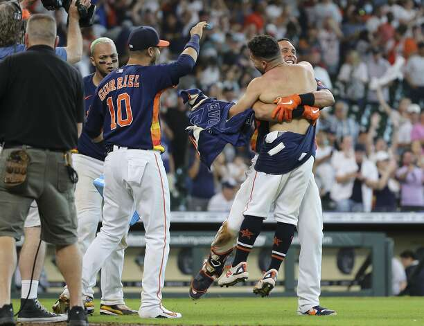 Houston Astros left fielder Michael Brantley (23) lifts second baseman Jose Altuve (27) up after Altuve hit a walk-off three-run home run and the Astros defeated New York Yankees 8-7 in a MLB game Sunday, July 11, 2021, from Minute Maid Park in Houston. Photo: Yi-Chin Lee/Staff Photographer / © 2021 Houston Chronicle