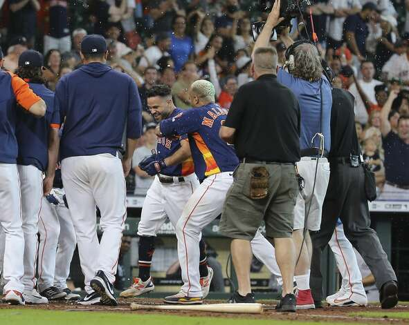 Houston Astros catcher Martin Maldonado (15) celebrates Jose Altuve (27) after Altuve hit a walk-off three-run home run and the Astros defeated New York Yankees 8-7 in a MLB game Sunday, July 11, 2021, from Minute Maid Park in Houston. Photo: Yi-Chin Lee/Staff Photographer / © 2021 Houston Chronicle