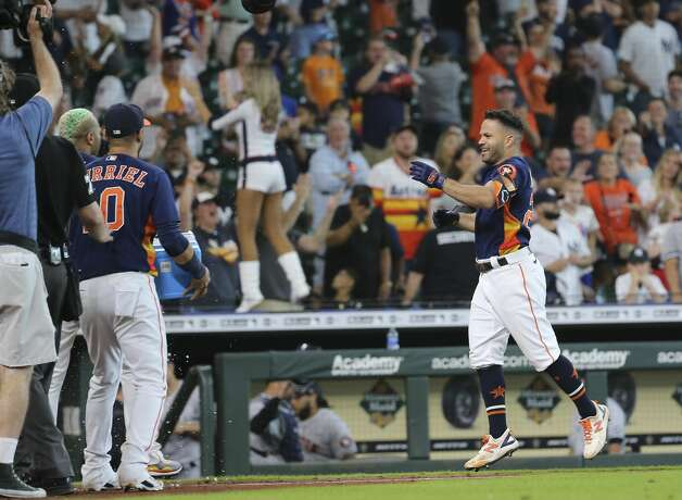 Houston Astros players congratulate second baseman Jose Altuve (27) after Altuve hit a walk-off three-run home run and the Astros defeated New York Yankees 8-7 in a MLB game Sunday, July 11, 2021, from Minute Maid Park in Houston. Photo: Yi-Chin Lee/Staff Photographer / © 2021 Houston Chronicle
