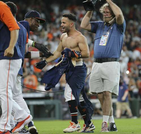 Houston Astros players and coaching staff celebrate second baseman Jose Altuve's walk off three-run home run and the Astros defeated New York Yankees 8-7 in a MLB game Sunday, July 11, 2021, from Minute Maid Park in Houston. Photo: Yi-Chin Lee/Staff Photographer / © 2021 Houston Chronicle
