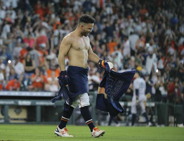 Houston Astros players ripped Jose Altuve's jersey after Altuve hit a walk-off three-run home run and the Astros defeated New York Yankees 8-7 in a MLB game Sunday, July 11, 2021, from Minute Maid Park in Houston. Photo: Yi-Chin Lee/Staff Photographer / © 2021 Houston Chronicle