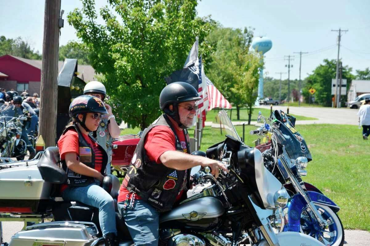 (From Left) Sawyer Hendrickson, 12, of Ludington, rode in the initial motorcycle leading the escort on Friday with John Stocki, of Rolling Thunder. (Arielle Breen/News Advocate)