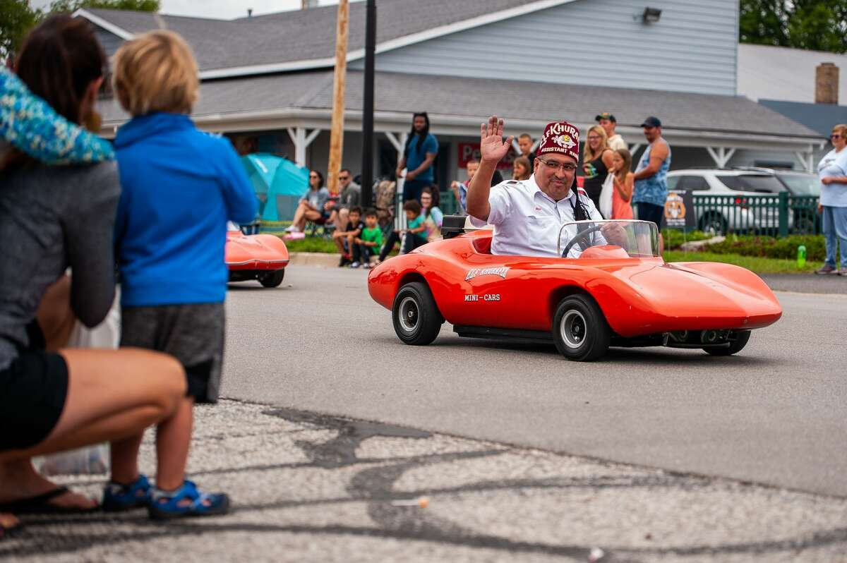 Floats roll and people spectate in the 2021 Auburn Cornfest Parade. This year marks the festival's 50th anniversary.