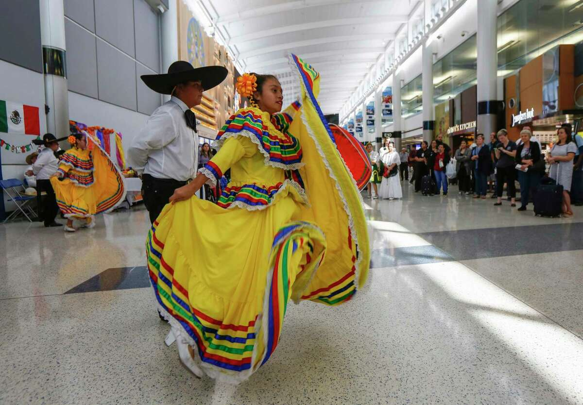 Burbank Middle School students dance at George Bush Intercontinental Airport as part of United Airlines' Hispanic Heritage Month Celebration in October 2019.