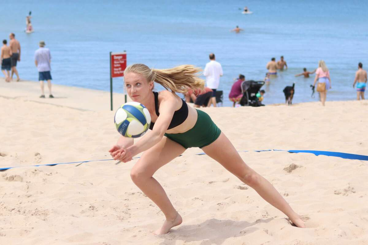 Youth volleyball players enjoy a fun, competitive tournament at Frankfort Beach on July 11.