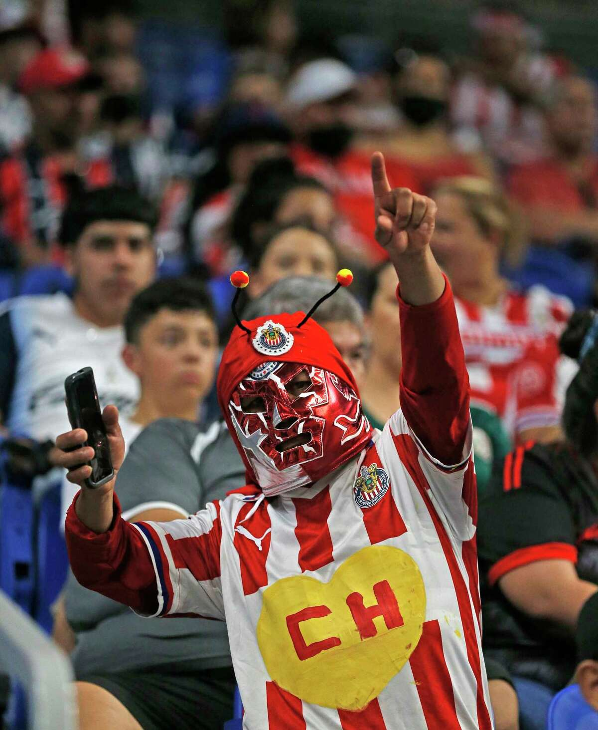 A Chivas fan cheer during Sunday's match againstMonterreyat the Alamodome. Monterrey won, 1-0.