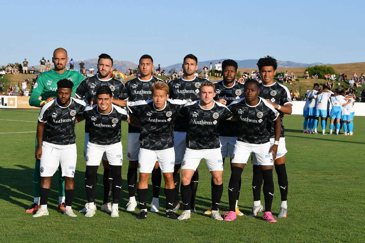 Oakland Roots SC starting XI before the game against Las Vegas Lights FC at Las Positas College Field in Livermore, CA on July 10, 2021. USL health and safety protocols forced the team to only have 13 players eligible for the game.