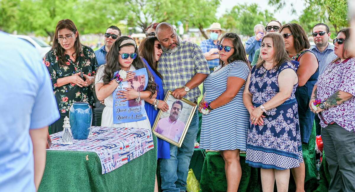 The family of Korean War Navy Veteran David Fuentes Sr. mourn him, Tuesday, July 6, 2021, as Fuentes is laid to rest at the Cavalry Catholic Cemetery during a Welcome Home Graveside Service with military honors. Fuentes's remains were relocated to Laredo after 32 years.