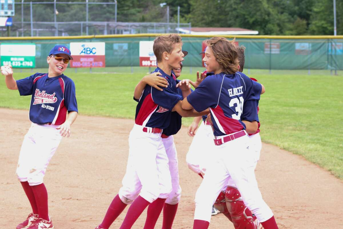 FNW players celebrate after winning the Distrcit 1 title July 11, 2021.