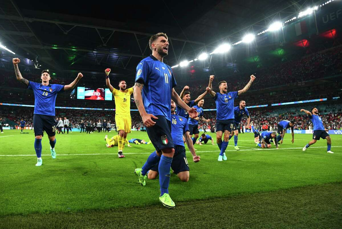 Domenico Berardi of Italy and teammates celebrate winning the Euro 2020 title over England. The final was decided on penalty kicks when the teams remained tied 1-1 after extra time.