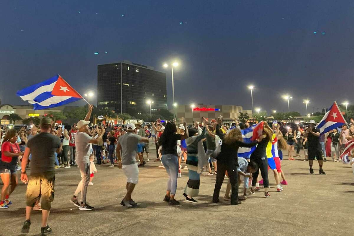 People gathered in the parking lot of PlazAmericas shopping mall to show support for Cubans facing food and medicine shortages.