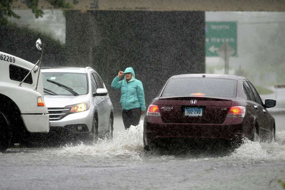 Cars sit stranded in flood waters from tropical storm Elsa at the intersection of Connecticut and Stratford Avenues, seen here from Bridgeport, Conn. July 9, 2021.