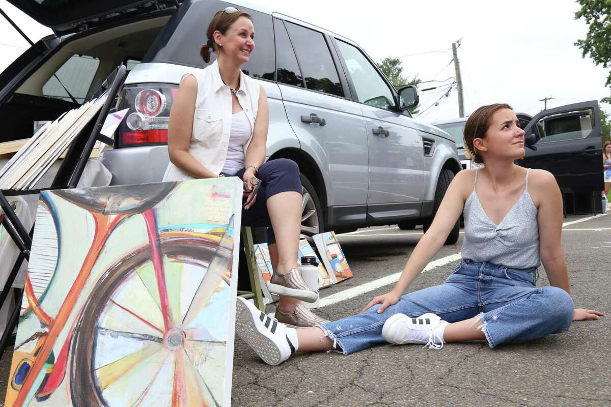 Artist Katya Lebrija of Wilton and her daughter, Natalia, engage with some visitors to the Artist Collective of Westport's trunk show at the parking lot by Jesup Green.
