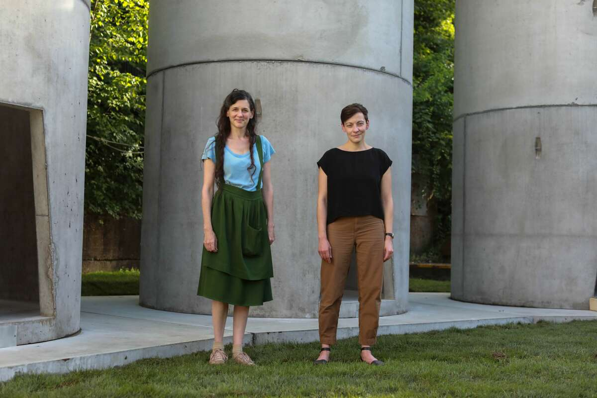 """Taryn Simon, left, and curator Alexandra Foradas standing with Simon's installation, """"The Pipes,"""" which was designed in collaboration with Shohei Shigematsu ofthearchitecture firm OMA.(Photo: Will McLaughlin)"""