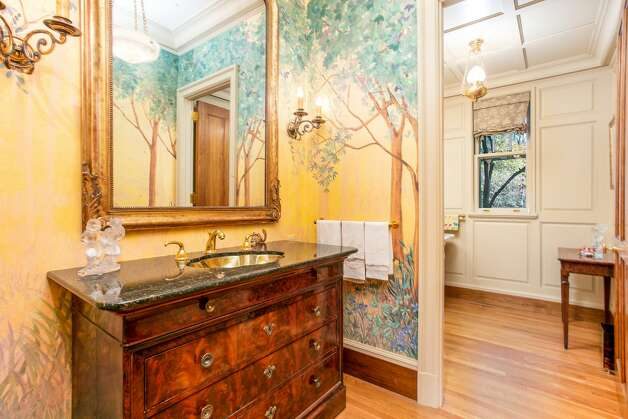 The bathroom in the home on 49 Mountain Spring Roadfeatures painted walls and ornate finishings. Photo: Corrado Galizia