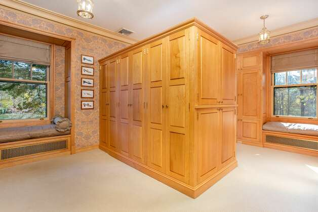 The walk-in closet and dressing space in the home on 49 Mountain Spring Roadfeatures ample storage and window seats. Photo: Corrado Galizia