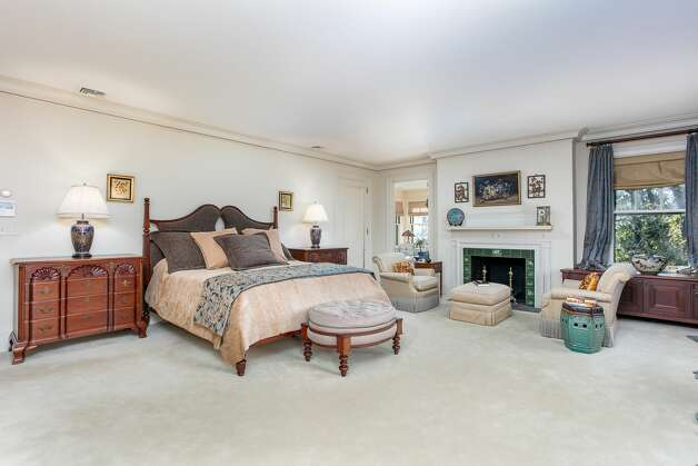 The primary bedroom in the home on 49 Mountain Spring Roadis one of five bedrooms in the house, which was designed by architectural firm Peabody and Stearns. Photo: Corrado Galizia