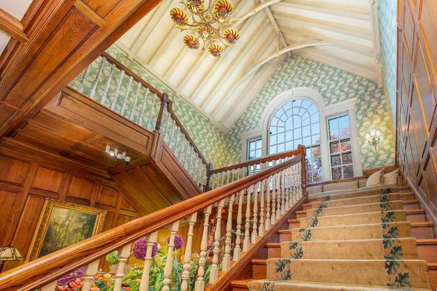 The main staircase in the home on 49 Mountain Spring Roadhas dramatic high ceilings and a large window on the landing. Photo: Corrado Galizia