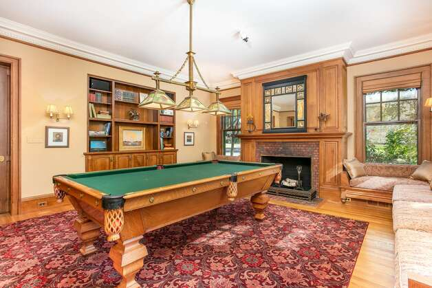 One of the rooms in the home on 49 Mountain Spring Roadis being used as a billiards room and has its own fireplace. Photo: Corrado Galizia
