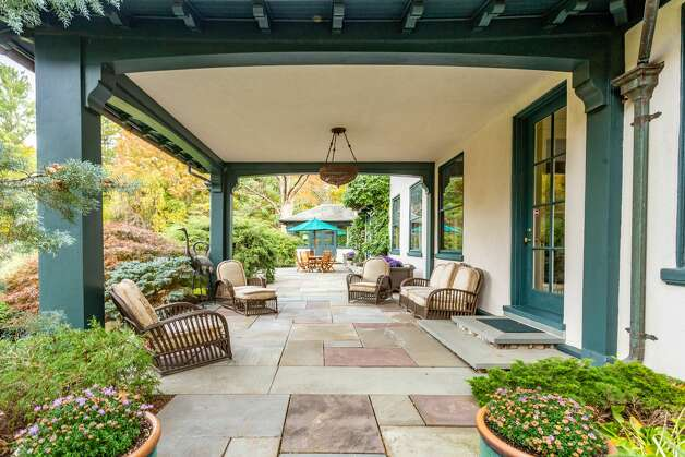 The 49 Mountain Spring Road homehas a large patio space that opens up to its 9 acres of land. Photo: Corrado Galizia