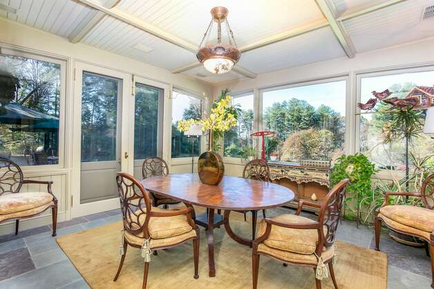 A dining porch part of the home on 49 Mountain Spring Roadhas radiant heat stone floors, according to the listing. Photo: Corrado Galizia