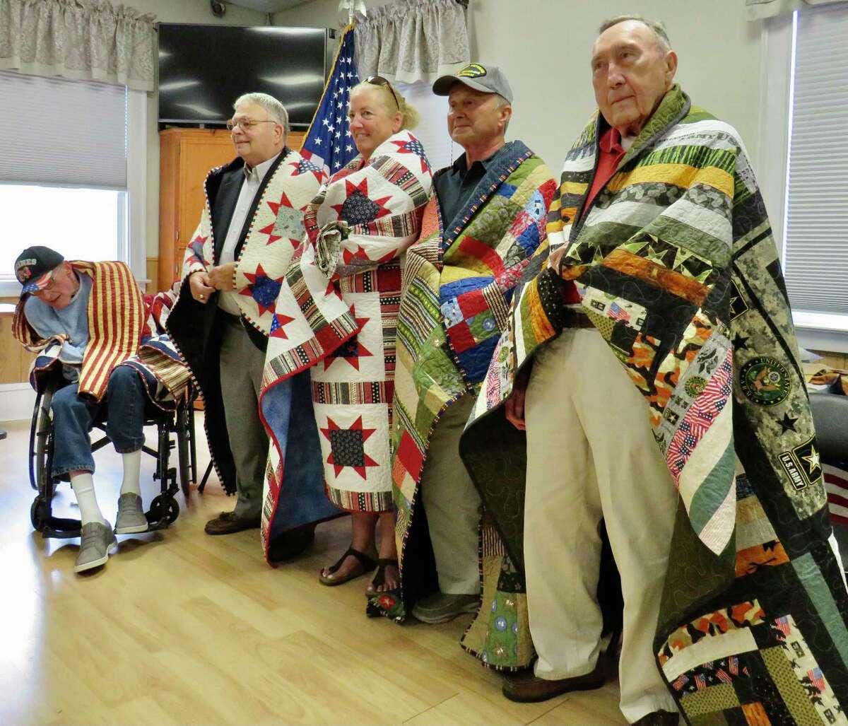 From left, Michael Simpson, U.S. Marine Corps; Michael Liberta, U.S. Army; Catherine Staunton, U.S. Navy; Robert Shirley, U.S. Army, and Richard Hopkins, U.S. Army.