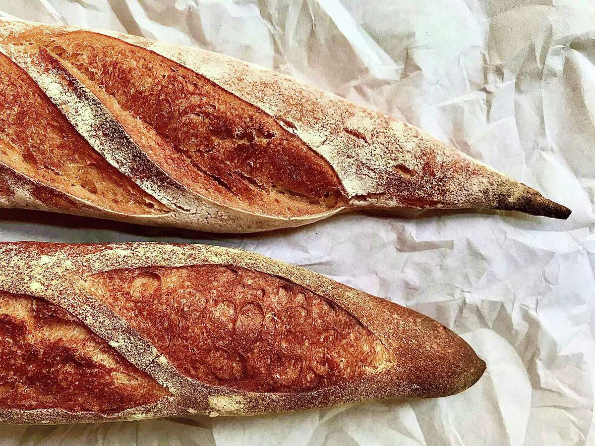 Organic sourdough baguettes from Artisana Bread are sold at the Urban Harvest Farmers Market.