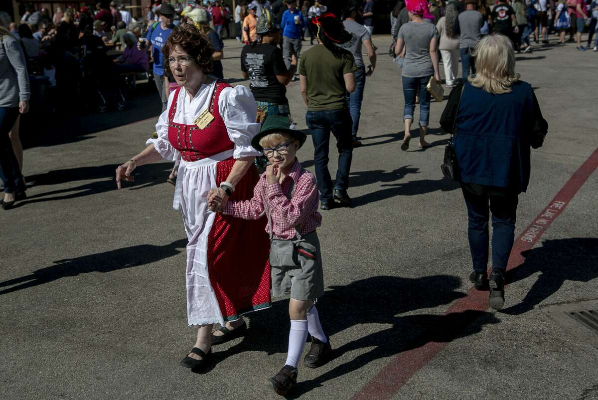 Kathy Dierksen and her grandson Benjamin Dierksen, 6, both of New Braunfels walk through the festival grounds during Wurstfest at Landa Park in New Braunfels, Texas, on Nov. 3, 2019.